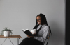 women reading the Bible happily with a cup in hand