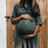 pregnant mom proudly showing her healthy baby bump