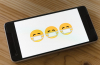 smartphone showing emojis wearing face masks