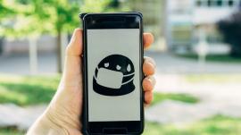 smartphone showing emoji wearing face mask