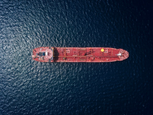 red tanker / ship in the middle of the sea