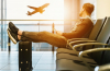man sits on gang chair inside the airport, left by his flight