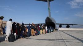 Passengers boarding a U.S. Air Force C-17 Globemaster III during the Afghanistan evacuation, Aug. 24, 2021.