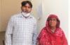 Rights worker Riaz Aasi with Christian sanitation worker Salima Rani Bibi.