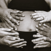 pregnant mom with many hands holding her tummy