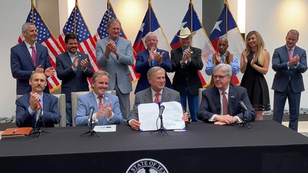 Gov. Greg Abbott during the signing of Texas' Senate Bill 1