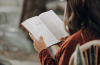 girl reading from the book of Proverbs in the Bible
