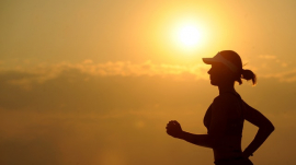 woman jogging under the sunset
