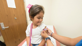 child getting vaccinated