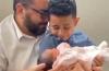 Pastor João Prudêncio Neto and son David with newborn baby girl Giovanna