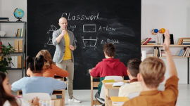 classroom scene where a teacher asks questions and students answer
